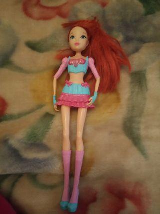 Barbie con ropa de goma
