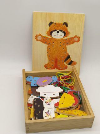 Juguete madera puzzle hilos