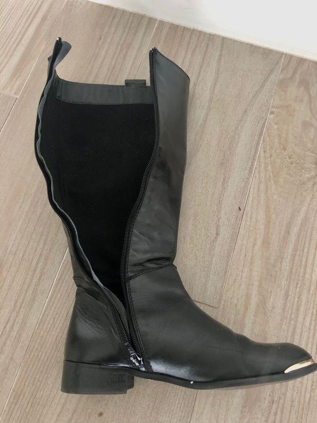 Botas altas planas negras mujer cuero