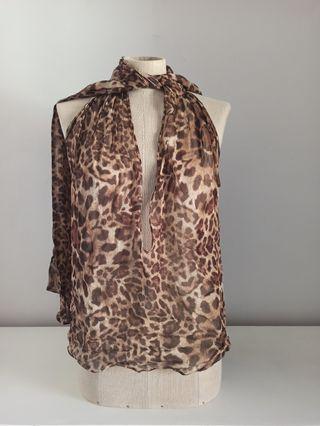 blusa multiposicion leopardo transparente
