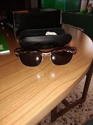 Gafas de sol con funda rígida