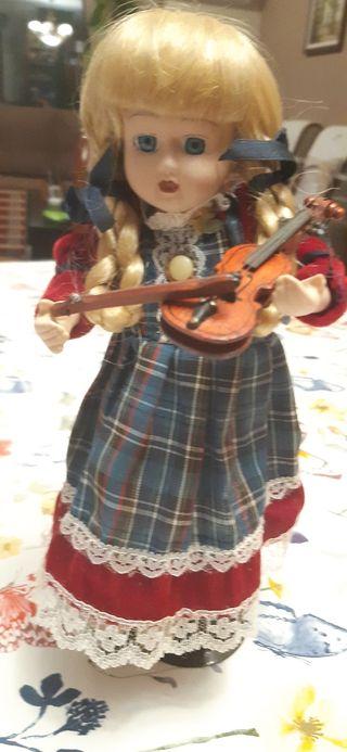 Vendo muñeca antigua de porcelana, autómata.