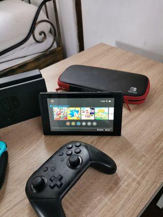 Nintendo switch + juegos + mando pro + funda