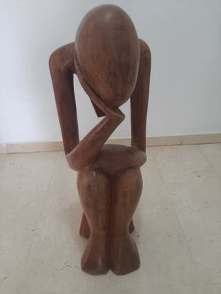 pensador de madera