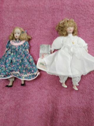 Muñecas d porcelana.