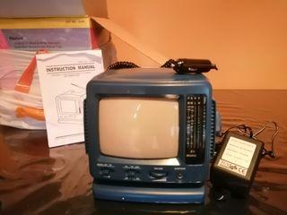 TV /radio blanco y negro con adaptador para coche.