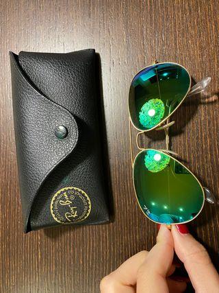 Gafas de sol Ray Ban dorado con cristal verde