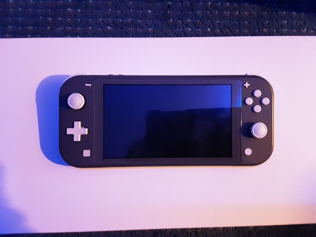 Nintednos switch lite with accessories and game