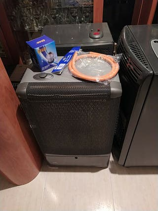 estufa de gas butano superser, con la goma valvula