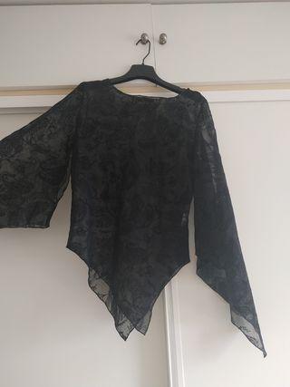 Blusa de fiesta transparente con detalles
