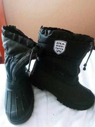 botas y guantes de nieve
