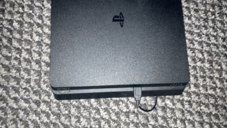 PS4 slim 500GB with Wireless Controller.