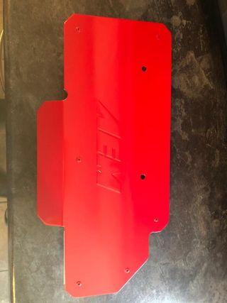 AEM heat shield in Ferrari red