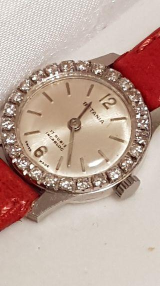 Reloj de oro y Diamantes con Correa de piel .