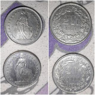 3 monedas de Francos Suizos.