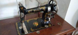 Antigua máquina de coser White americana y mueble