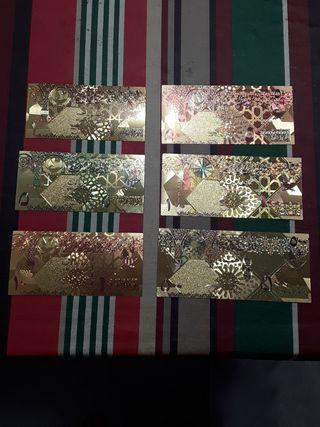 reproduccion en billetes de papel oro catar qatar