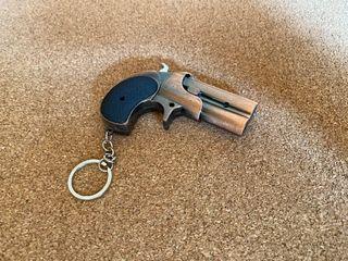 Puntero láser en forma de pistola
