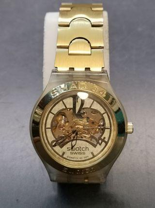 reloj swatch irony automático shaq 34 dorado