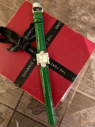 Reloj oro blanco 18k , diamantes 0,60qt