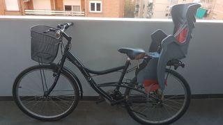 bicicleta de paseo con cesta y sillita