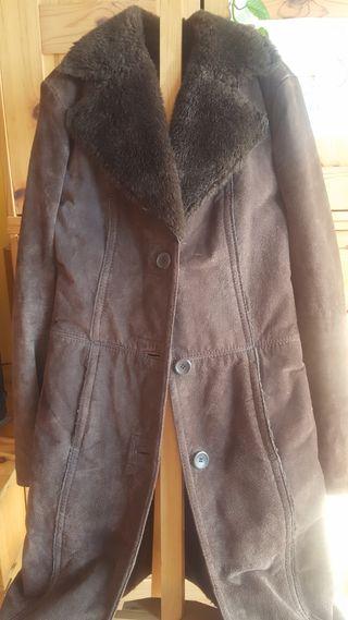abrigo de piel vuelta