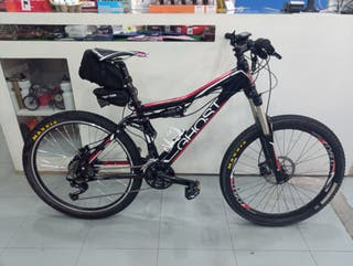 Bicicleta MTB doble susp. con motor eléctrico.