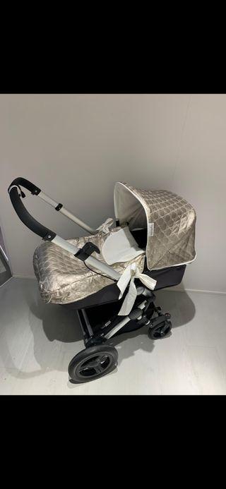 Carro bebé con vestimenta