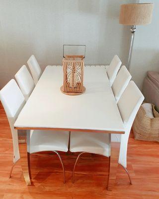 Conjunto mesa salón de mármol y acero.