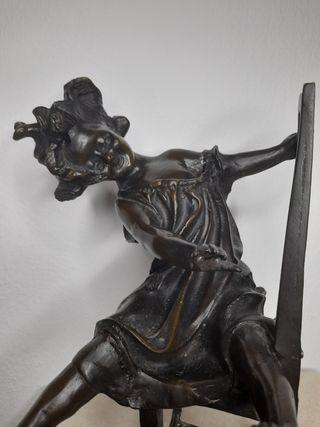 figura de bronce