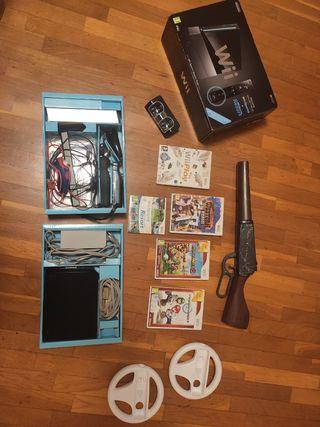 Nintendo Wii negra con juegos