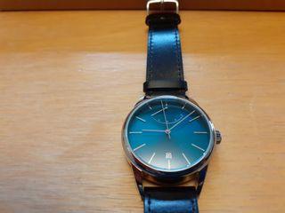Reloj mecánico manual con reserva de marcha