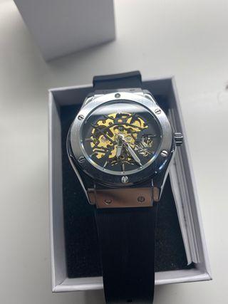 Reloj hombre.