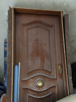 Puerta de entrada acorazada de izquierda