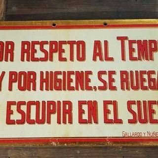 Antiguo cartel de hojalata