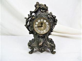 Antiguo reloj de bronce de sobremesa carga manual