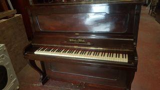 piano vertical pared,,hay varios