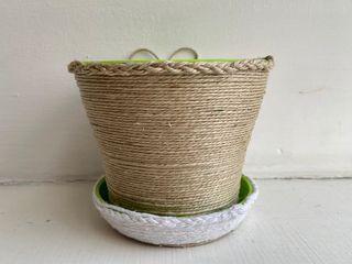 Plastic flower pot with jute twine