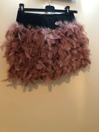 Mini falda de plumas color rosa palo
