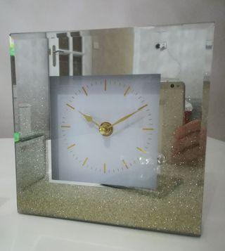 reloj decorativo de espejo