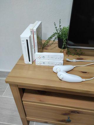 Wii con 2 juegos y 2 mandos