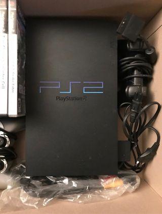 Consola Ps2 con caja original y 10 juegos.