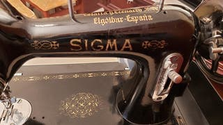 Máquina sigma antigua eléctrica