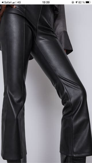 FLARED LEATHER TROUSERS.