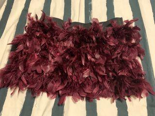 Mini falda plumas