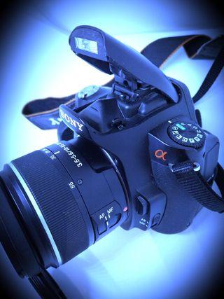 cámara réflex Sony impecable
