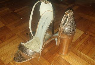 Sandalias doradas altas