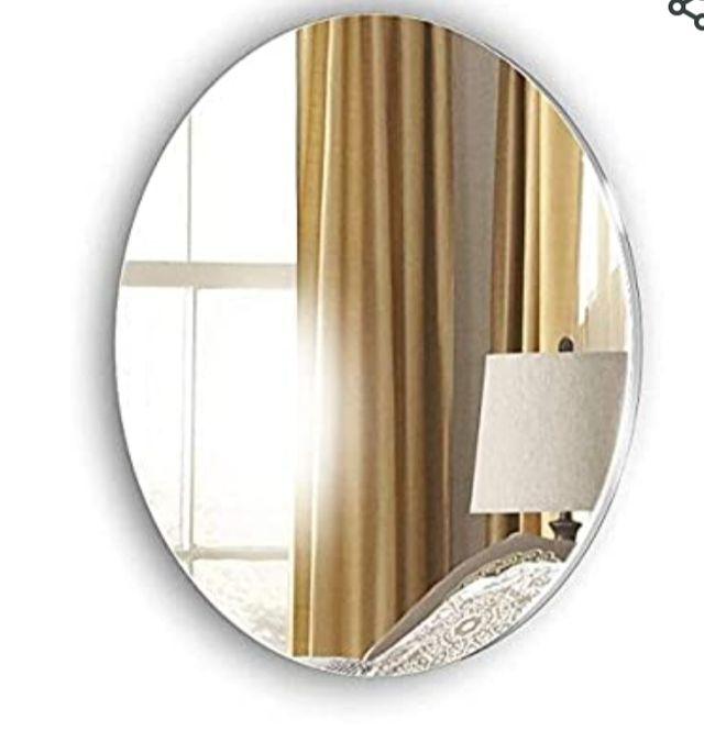 Espejo ovalado pared.