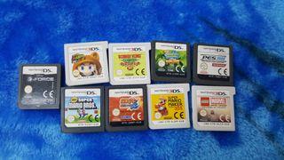 Nintendo 2ds con funda y juegos.