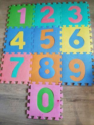 Alfombra de goma tipo puzzle para bebés y niños.